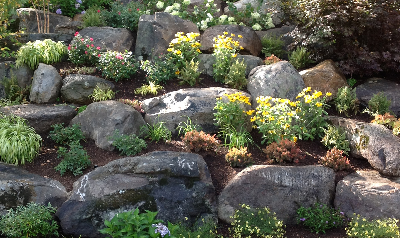 Garden boulders boulder and rock selection placement for Rock landscaping ideas