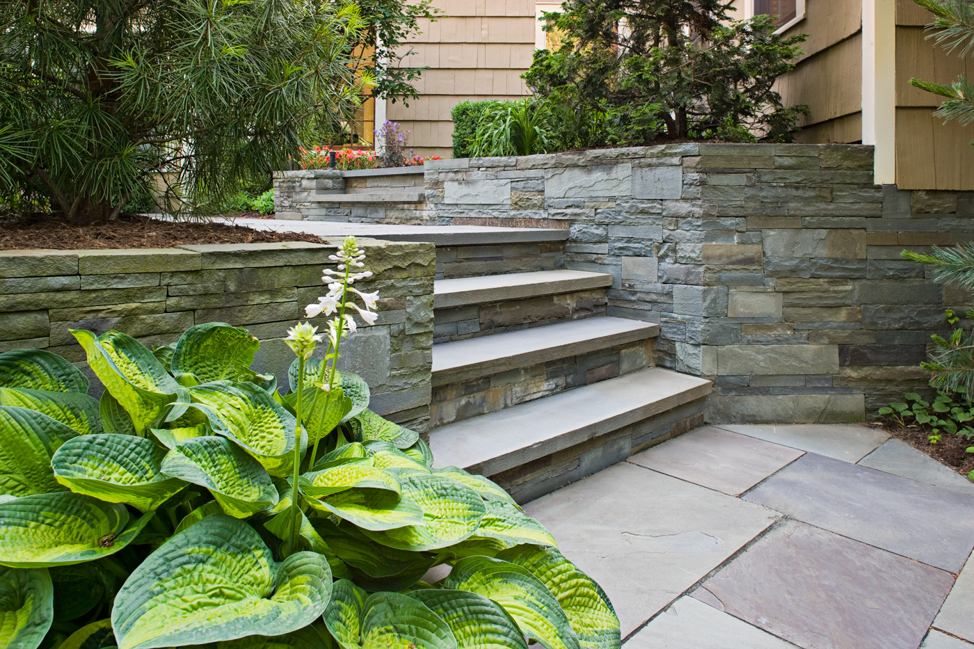 Built stone steps retaining walls natural stone for Landscaping stones