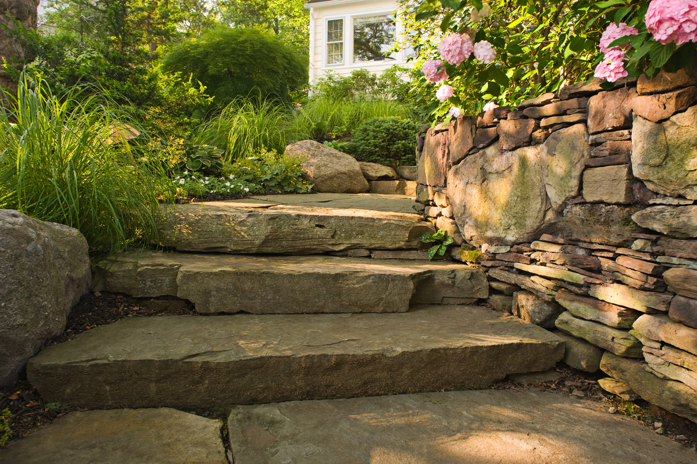 Natural stone steps by cording landscape design cording for Pictures of stone steps