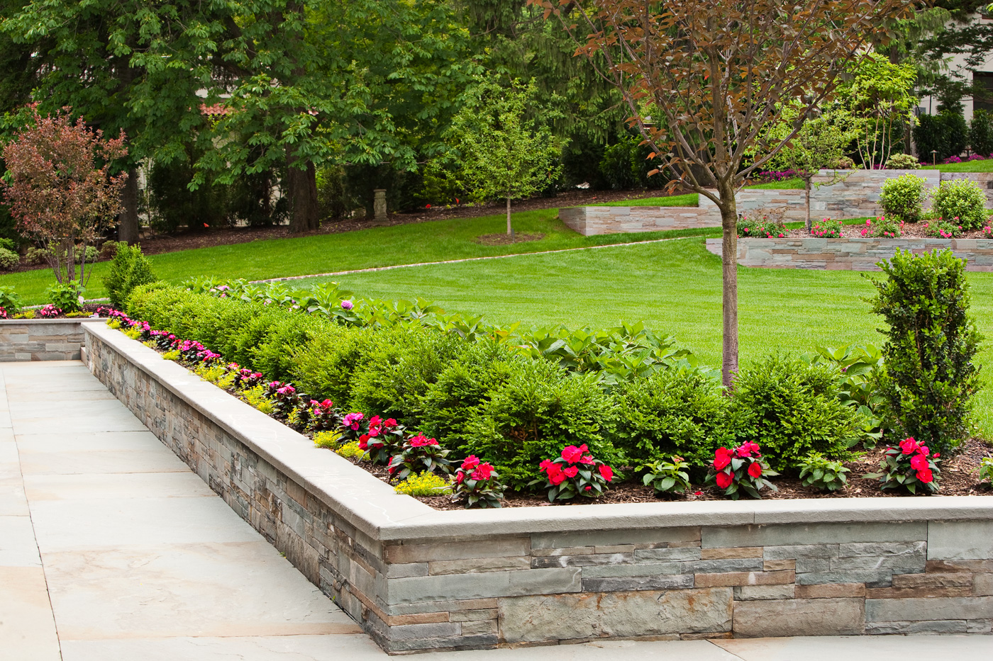 Stone Seat Wall by Cording Landscape Design Cording Landscape Design