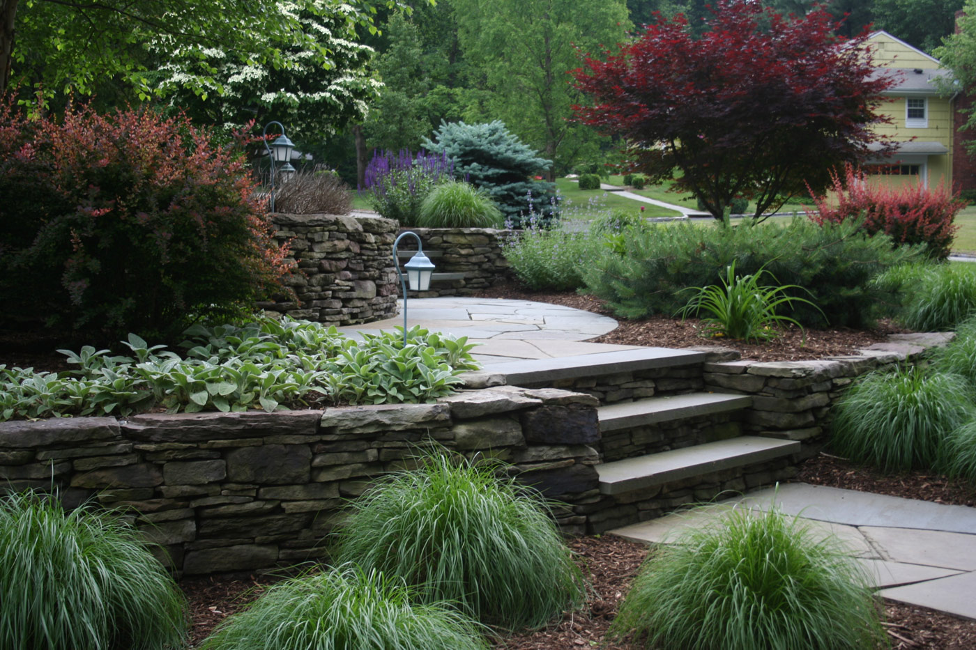 Natural Stone Retaining Wall by Cording Landscape Design
