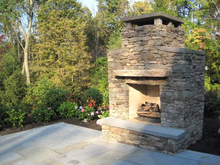 Outdoor Stone Patio Fireplace by Cording Landscape Design