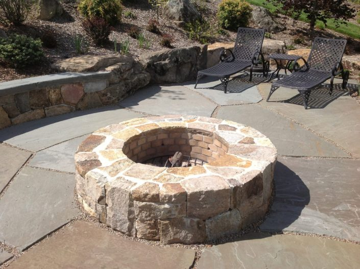 Outdoor Stone Firepit by Cording Landscape Design
