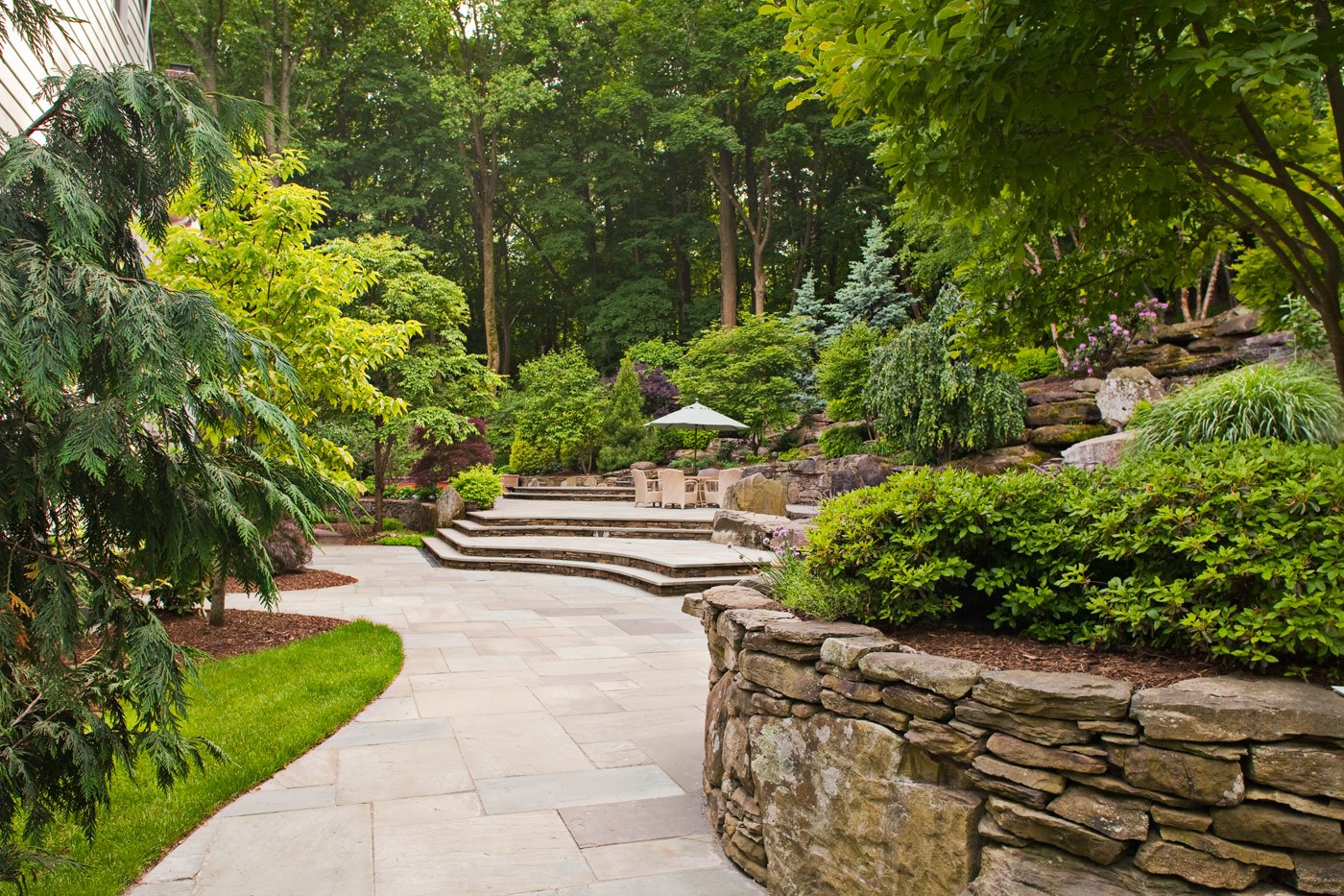 Natural stone patio by cording landscape design in nj for Natural landscape design
