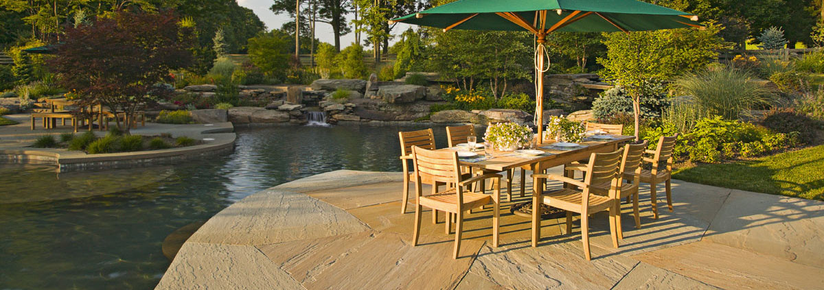 Design: Cording Landscape Design, Inc. Patio & dining furniture next to naturally designed pool