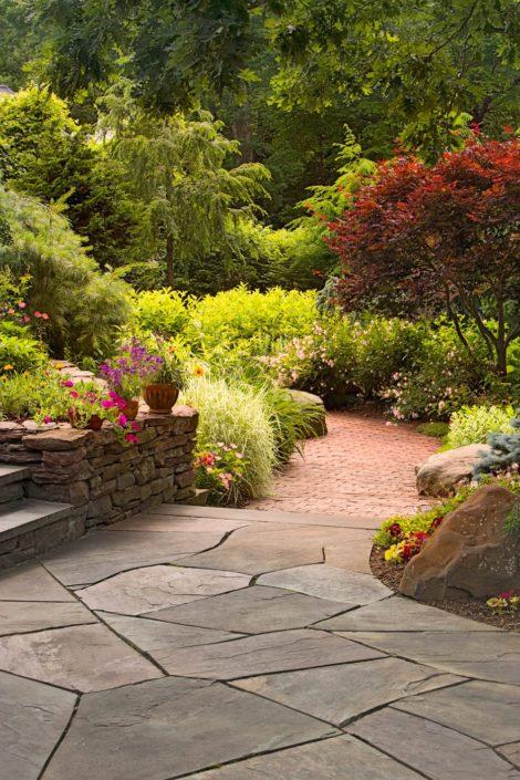 Irregular Bluestone Patio by Cording Landscape Design in NJ